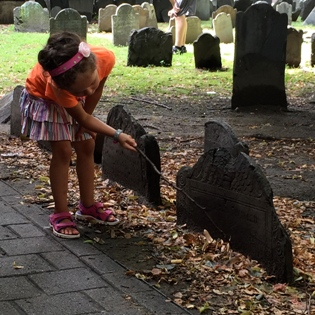 niece scraping mud off headstone